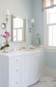 Shutters, big molding,beautiful blue walls, and lovely vanity for powder room.