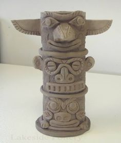 Totem pole vase. Site has good hand building tutorials