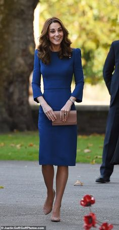 Kate was impeccably co-ordinated for the occasion, matching her nude Mulberry clutch to he... #katemiddleton
