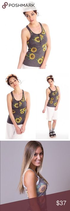 Wildfox Sunflower Contempto Tank 90's Worn once excellent condition! Size medium. Contempo Sunflower Tank is a soft shade of charcoal grey and is brought to life with a bouquet of sunflowers that are throughout this razorback tank. Three black buttons cascade off of the scoop neck tank. Made in the USA by WILDFOX Couture. Wildfox Tops Tank Tops