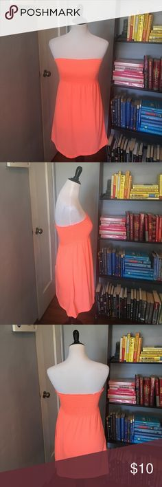 Neon Orange Bandeau Swim Cover-Up This is such a cute and comfortable coverup. It has a smocked bandeau top and flowy botttom. Perfect for the beach or pool! Swim Coverups