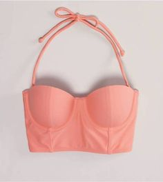 i wouldn't actually wear this , but I just like looking at these lol. pink cute bustier crop top, salmon pink , straps
