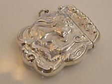EMBOSSED STERLING SILVER VESTA CASE SMOKING LADY