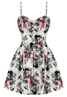 Hell Bunny Eden Dress, this adorable dress is at Hottopic right now. It's a great collage of skulls, feathers, and flamingos. Oh My!