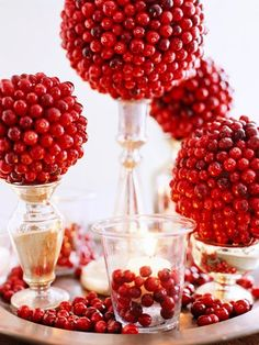 DIY - Hot glue cranberries to styrofoam balls to make beautiful decorations, ornaments or use as a centerpiece for you Holiday Table. <3