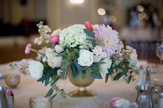 Beautiful floral centerpiece from J. Costello Designs displayed within Lovett Hall Ballroom