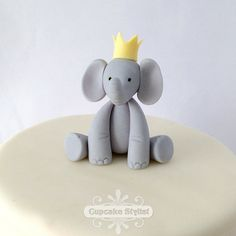 This adorable gray elephant is wearing a crown, is made of edible fondant, and is the perfect decoration for your little princes cupcake or cake.