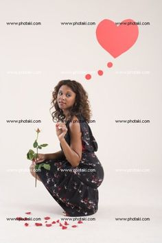 http://www.photaki.com/picture-a-woman-holding-a-rose_1322469.htm