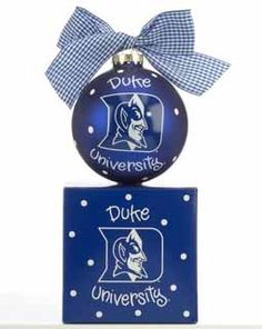 A Duke University Blue Devil fan will love to have this ornament personalized with their name!  The glass ball is Duke blue with a picture of the Blue Devil on the front.  A blue and white checkered ribbon is tied on the top and it comes in a matching gift box.  Buy it now for $21.95 at www.ornamentshop.com