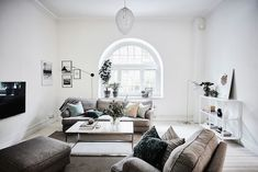 Sitting room in an elegant Swedish apartment in shades of grey. Entrance.