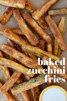 This easy zucchini recipe is a healthier alternative to French fries (and a great way to sneak veggies onto kids' plates!) but still satisfy that craving for a hot, salty, crunchy snack. | Crispy Baked Zucchini Fries recipe from justataste.com #zucchinirecipes #zucchini #zucchinifries #bakedzucchinifries #snacks #healthysnack #recipes #justatasterecipes