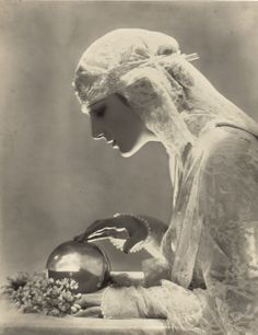 """"""" Dolores - 1919 - Photo by Baron Adolf de Meyer - 'Eager-eyed from under her bridal veil, she gazes in the fortune-telling crystal, hoping to see her dreams. Fortune Telling, Vintage Gypsy, Vintage Beauty, Vintage Dance, Vintage Circus, Vintage Ladies, Vintage Photographs, Vintage Images, Gypsy Fortune Teller"""