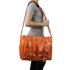 "libby bag in orange ... $249.00    outside dimensions:   16"" (length) x 6.5""(width) x 13.5""(height)    outside specs:   Front:  • 2- 6.5"" x 7.5"" zipper pockets  • 1- 10.5"" zipper pocket  Sides:  • 2- 6.5"" x 8.5"" open pockets  Back:  • 1 - 11"" zipper pocket(will fit IPad)    inside specs:   • 1 - laptop divider - Will hold up to a 17"" laptop  • 5- padded, removable, adjustable dividers  • Exterior walls & bottom of the bag are padded    misc:  • 2 - over the shoulder straps(11"" height)  • 1…"