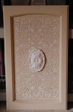 Plaster-stenciled cabinet door.