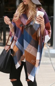 This is by far one of the cutest accessories of the season!! We are in love with this fun and fab fall print with gorgeous hues of blue, orange, purple, ivory and burgundy. You can wear this accessory as a poncho by using the cute toggle or as an oversized blanket scarf! Whatever way you choose to wear it, you are sure to look amazing!