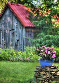 Old barn, wagon wheel, flowers