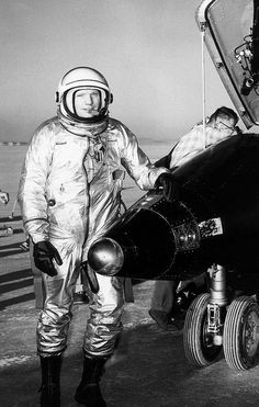 (1960) NASA test pilot Neil Armstrong is seen here next to the X-15 ship #1 (56-6670) after a research flight. The X-15 was a rocket-powered aircraft 50 feet long with a wingspan of 22 feet. It was a missile- shaped vehicle with an unusual wedge-shaped vertical tail, thin stubby wings, and unique side fairings that extended along the side of the fuselage.