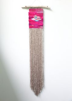 """One-of-a-kind handwoven wall hanging. Materials include yarn remnants and wool. 5.25"""" x 32"""" Tied to found driftwood and ready to hang...."""