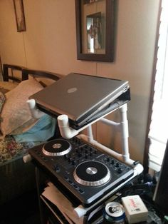 Picture of PVC DJ Laptop and Mixer Stand--- I'm wondering if I could modify the idea and affix it to the handles/control panel of the treadmill???