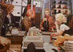 Legend: VIVIENNE WESTWOOD (in tartan bondage jacket), DEBBIE JUVENILE (in waistcoat), TRACIE O'KEEFE (behind the till) inside SEDITIONARIES, circa 1977/78. Note the boarded up window on the right - probably smashed in by disgruntled Teddy Boys or football hooligans. PunkPistol @ www.SEDITIONARIES.com