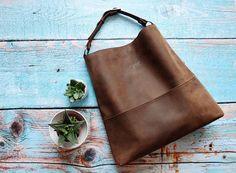 Genuine leather hobo bag with regulated handle leather