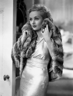 Carole Lombard. After the 1929 stock market crash, the boyish looking flapper clothes and severe hair styles of the 1920s were replaced by more feminine clothes and softer, curlier hair.