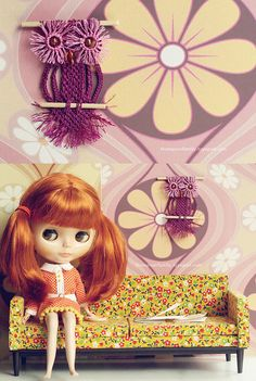 Love the vintage Blythe look on this one. I still have an original one. When you pull the string she blinks and her eyes change color.