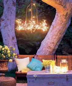 outdoor chandelier hanging off the tree