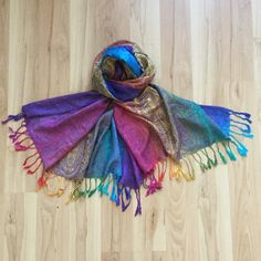 Luxurious Pashmina Scarf/Wrap Beautiful super soft lightweight Pashmina Scarf. Very bright and rich colors. 65in by 27.5in.  Can also be used as a wrap. Accessories Scarves & Wraps
