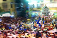 The silver chariot carrying the image of Lord Murugan makes it way to Nattukottai Chettiar Temple, Waterfall Road from Kovil Veddu, Queen Street at 6.30am this morning where thousands of devotees have gathered there from as early as 5am to celebrate Thaipusam in Penang.