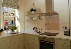 Soft green bright airy kitchen with Neff appliances Holiday Accommodation, Luxurious Bedrooms, Catering, Kitchen Cabinets, Appliances, Bright, Luxury, Green, Home Decor