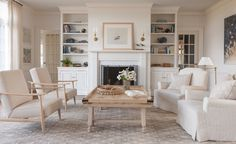 A fresh, white Living Room in a Beach House with slipcovered upholstery  Family Room  Great Room  Living  Media  Coastal  Contemporary  TraditionalNeoclassical by Liliane Hart Interiors