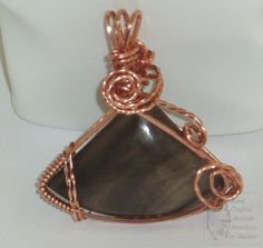 Sold! Commissions Welcome. Petrified Wood and Copper pendant. The Cabochon used in this pendant was cut and polished  in our #Lapidary Workshop.