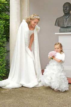 How amazing for a winter wedding! Love the fur cover for flower girl... not so much for bride.