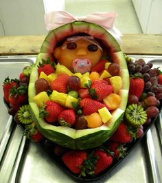 HOW ADORABLE!!! Saw this at a Baby Shower! Watermelon bassinet - baby's head is a carved cantaloupe, grapes for eyes - assorted fruit for the blanket.