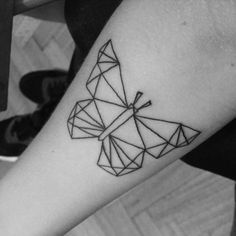 Polygonal style butterfly on the forearm.