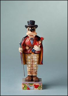 """Jim Shore Disney Traditions  Goofy as Drosselmeyer    Jim Shore brings The Nutcracker to you in his Disney Traditions collection!    Specifications:  Size: 5""""H x 1""""W x 2""""L  Materials: Stone Resin   Note: Unique variations should be expected; hand painted    Your Price: $20.00"""