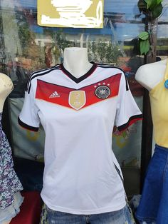 GERMANY 2014 WORLD CUP CHAMPION 4TH TITLE IN BRAZIL HOME JERSEY ADIDAS SHIRT TRIKOT MEMORABILIA COLLECTIBLE WOMEN, LADIES, FEMALE, YOUTH / CODE # M35023 Germany Kit, World Cup Champions, Vintage Jerseys, Adidas Shirt, Football Jerseys, Jersey Shirt, Fifa, Brazil, Youth