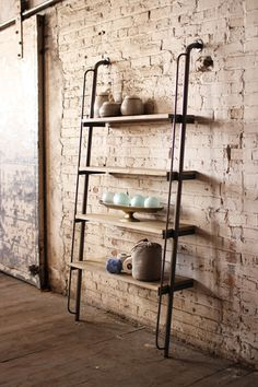 large wood and metal leaning shelving unit  $595.00