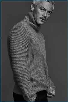 Embracing a chic image, Luke Evans wears a ribbed wool turtleneck sweater from Acne Studios with Balenciaga trousers.