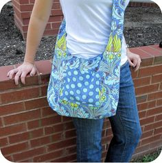 Hi friends! Today I'm sharing a sewing project!  I made a reversible sling bag using a tutorial from Crap I've Made. I haven't decided which...