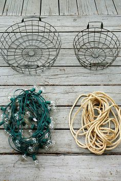 DIY your own outdoor chandelier with a few wire baskets, rope and lights.