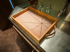 Upcycled century-old barn wood is accented with a patinaed copper panel and leather handles to make up this M.F.E.O. serving tray. The unique piece was handpicked for use in the bar area/entertainment room of DIY Network's Blog Cabin 2015.