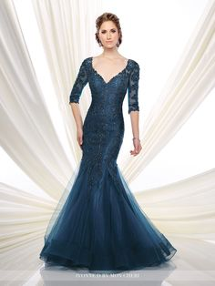 Hand-beaded tulle and lace over taffeta trumpet gown with beaded illusion three-quarter length sleeves and curved V-neckline over sweetheart bodice