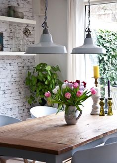 Exposed brick wall painted white aged, thick white floating shelves, fresh flowers, chunky wooden table and industrial ceiling pendants - design-h-ideas Home Design, Interior Design, Stylish Interior, White Floating Shelves, Exposed Brick Walls, Whitewashed Brick, Ceiling Pendant, Pendant Lights, Pendant Lamps