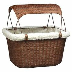 This essential pet bicycle basket lets you enjoy rides through the park with your four-legged companion. The wicker-inspired design is lined with faux sheepskin for style and comfort, while a removable sunshade and safety leash keeps your pet cool and secure while you travel.     Product: Pet bicycle basketConstruction Material: Synethic rattan wicker, sheepskin and faux leatherColor: Brown and whiteFeatures:  Suitable for pets up to 13 poundsRemovable sunshadeAdjustable safety seat to keep …