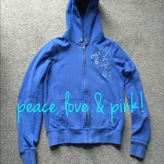 PINK XS blue zip up sweatshirt PINK blue zip up sweatshirt size XS silver foil heart design on front and silver foil peace sign with hearts on back. Missing string for hood but otherwise EUC. No rips or stains. PINK Victoria's Secret Other