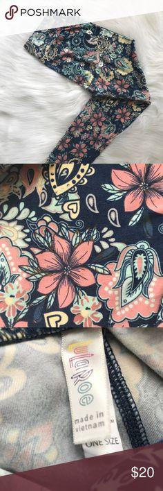 Os Lularoe leggings Gorgeous floral leggings with sea foam green , pale yellow , light coral and white OS Lularoe leggings . Worn once. No rips or marks. LuLaRoe Pants Leggings