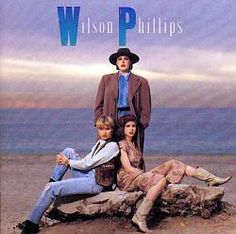 """Wilson Phillips: Wilson Phillips first appeared in 1990 flaunting a harmony-rich sound that helped send three singles from their first album -- """"Hold On,"""" """"Release Me,"""" and """"You're in Love"""" -- to the top of the Billboard charts. Carnie Wilson, Wendy Wilson, and Chynna Phillips comprised the vocal trio, whose sudden success was matched by an equally impressive pedigree."""