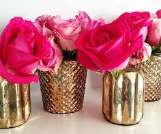 Gold candle/votive holders used for flower arrangements...Or paint textured votive holders w/ mercury glass paint! Fabulous!